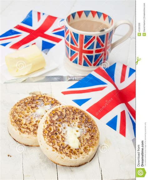 British Toaster Buttered English Crumpets With Cup Of Tea And Flag In