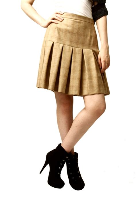 castillo knee length pleated skirt from east