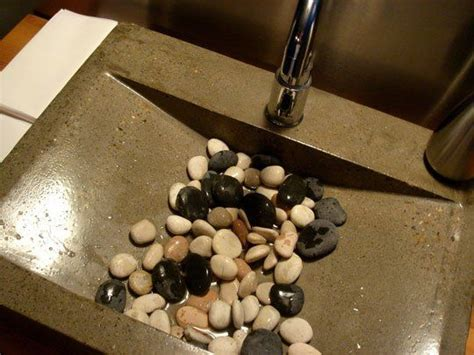 river rocks in bathroom sink look stones in the sink