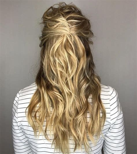 twist and pin style half up half hairstyle