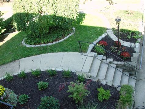 landscape designs for backyard slopes sloped front yard landscaping ideas images