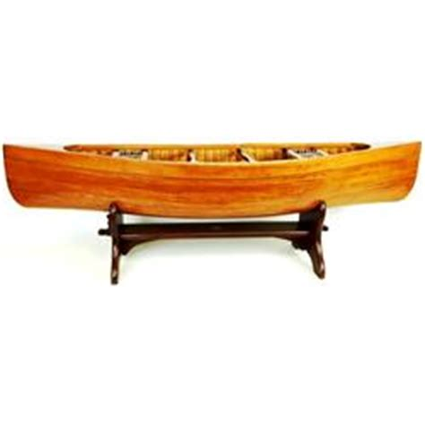 crafted miniature canoe coffee table