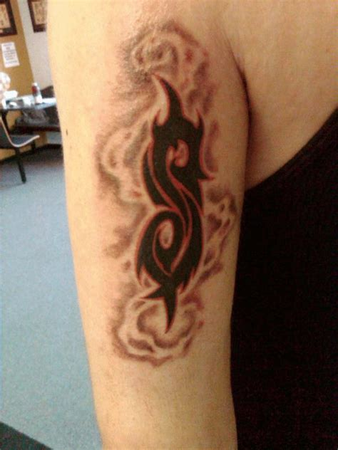 white ink tribal tattoo slipknot tribal logo on arm sleeve by roberttrouten