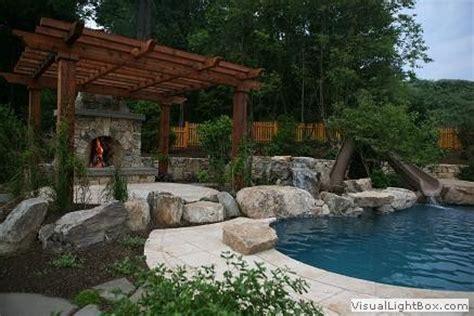 pergola raised patio fireplace pool  waterslide