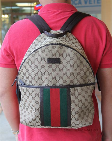gucci monogram supreme canvas zip mens backpack