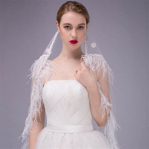 white bridal veil floor length gorgeous feather decorated