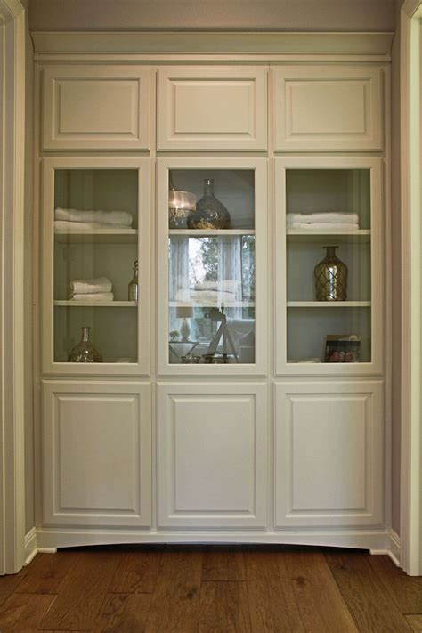 bathroom linen cabinet with glass doors burrows cabinets bathroom floor to ceiling linen cabinets