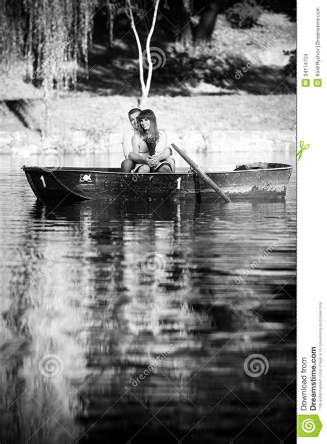 Black And White Photo Of Couple On Boat Stock Photo