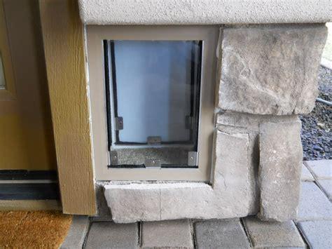 Exterior Door With Pet Door Installed Hale Security Pet Door Installed Through An Exterior Wood Frame With Rock Wall Yelp