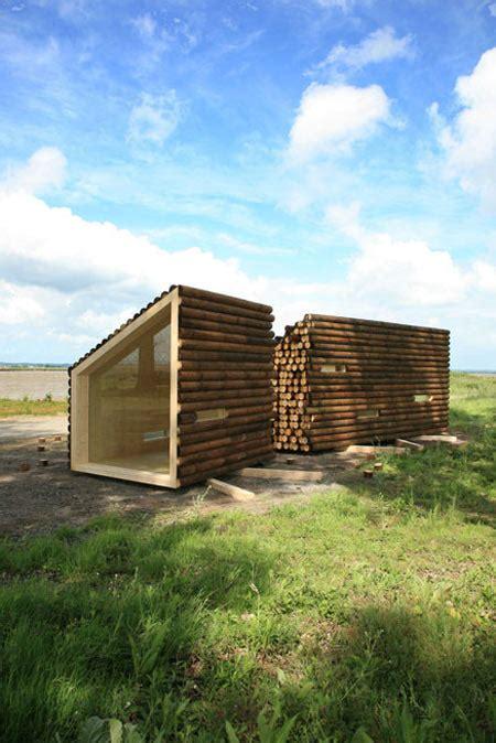 Portable Log Cabins by Olgga S Portable Log Cabin Conceals A Sleek Modern