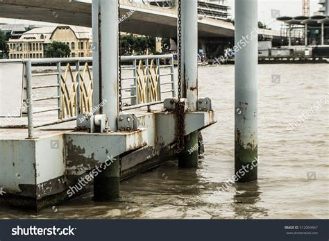 boat landing pole waterfront landing boats moss on pole stock photo