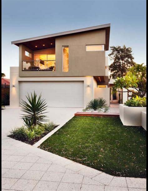 fachadas de garage frentes de casa con garage doble