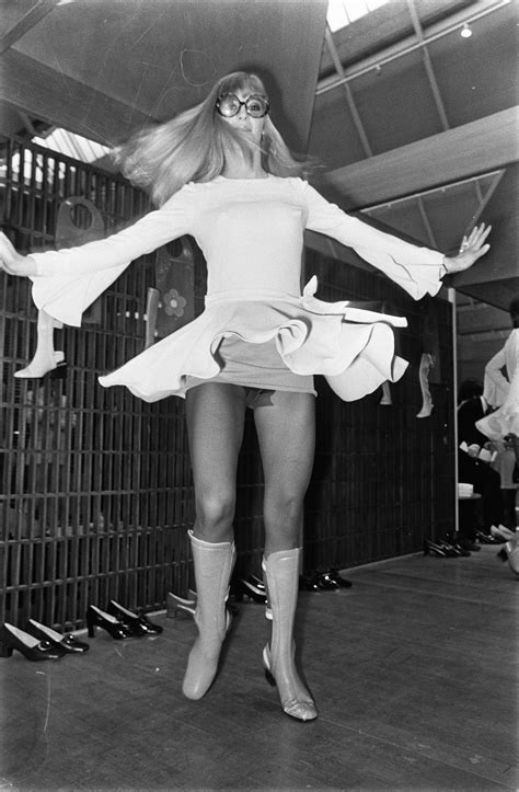 file twirling model in miniskirt and tights at mary quant