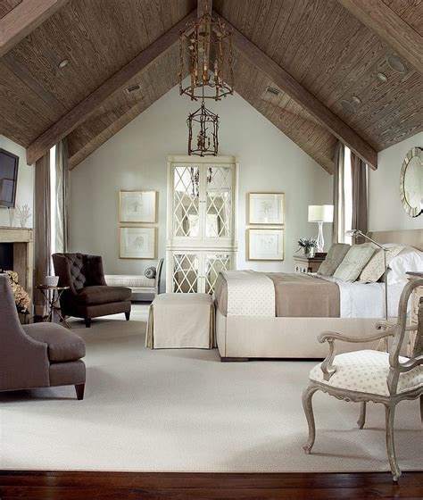 vaulted bedroom bedroom with soft tones fireplace and vaulted ceiling