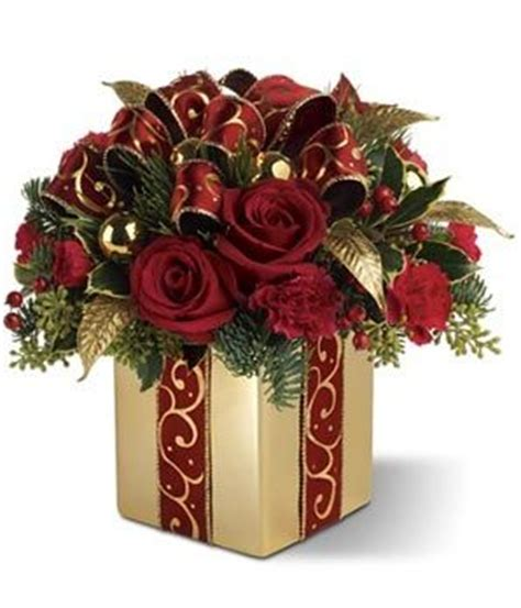 25 best ideas about christmas floral arrangements on