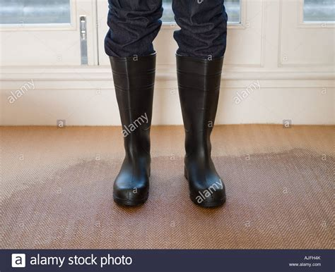 wearing rubber boots person wearing rubber boots on a carpet stock photo