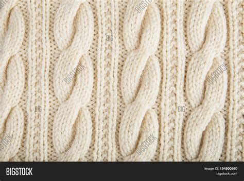 knitting pattern photography knitted jersey background with a relief pattern stock