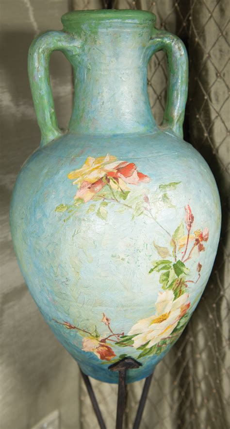 large decorative ceramic water jug and stand
