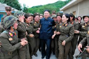 photos of north korea leader kim jong un surrounded by