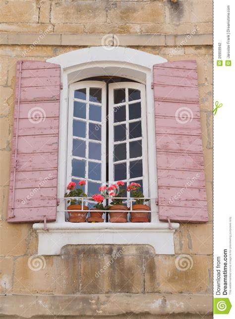 French Country House Plan traditional french window with pink shutters stock