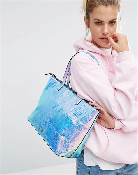 Talent Management Cases And Commentary By Eddie Blass Ebook E Book lyst skinnydip cosmo iridescent shoulder bag multi in blue