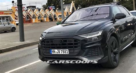 Audi Q8 Black audi q8 drops the camo for testing in moscow
