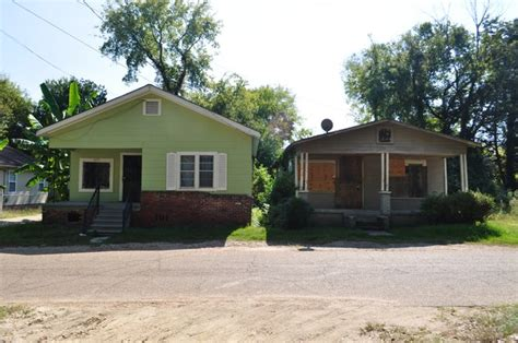 two houses side by side facing the odds in the washington addition jackson free press jackson ms
