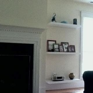 floating shelves around fireplace great room