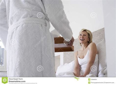 how to romance a woman in bed man serving breakfast to cheerful woman in bed royalty free stock photos image 33888958