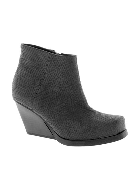 black boots cheap cheap monday angle low snake ankle boots in black lyst