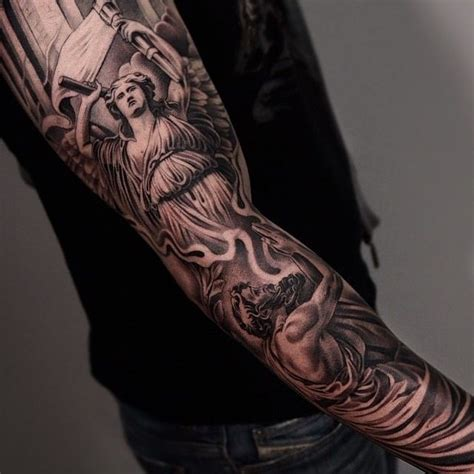 tattoo angel sleeve amazing artist jun cha lower arm view of an angel tattoo