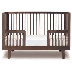 sparrow crib toddler bed conversion kit in walnut and