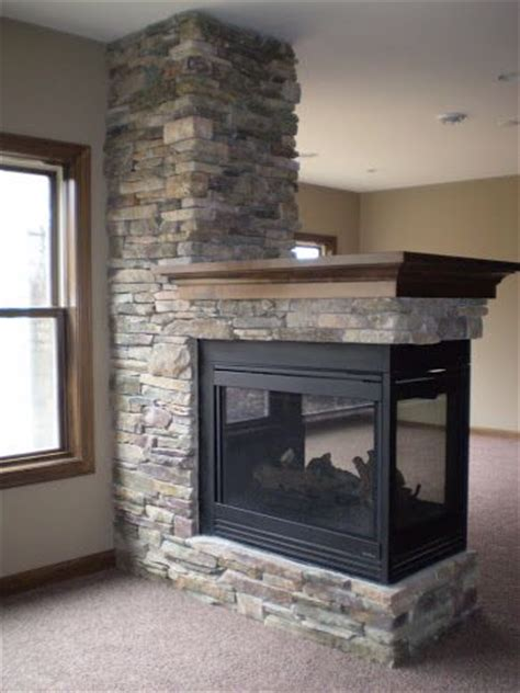 3 sided fireplace with wood mantle in this ldk lower