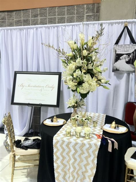 Bridal show booth Tall centerpiece all white flowers with