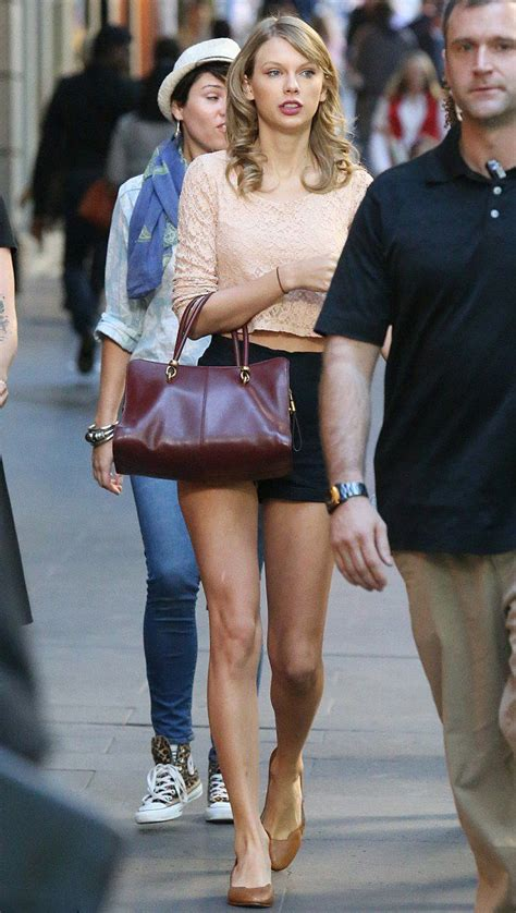 taylor swifts legs look amazing in short shorts photos taylor swift wore a pair leg flashing black high waisted