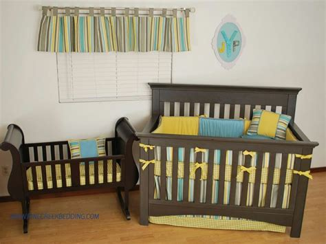 A Stripe Tab Top Valance With Coordinating Gold And Aqua Coordinating Crib Bedding For
