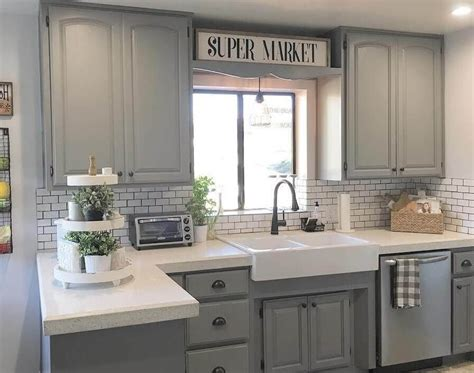 grey stained cabinets like the lighter grey 2nd but the flat drawer profile of the 3rd light grey stained kitchen cabinets with white tile