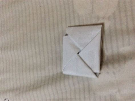 How To Fold Paper Into A Triangle - how to fold paper into a secret note square 10 steps