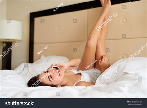 laying down in bed woman lying upside down bed legs stock photo 280018451
