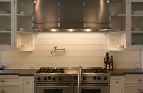 white glass subway tiles transitional kitchen