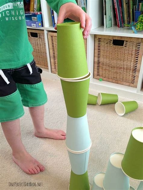 what is a fun game to play at christmas with family 10 using paper cups we simple play ideas that can be put together quickly and