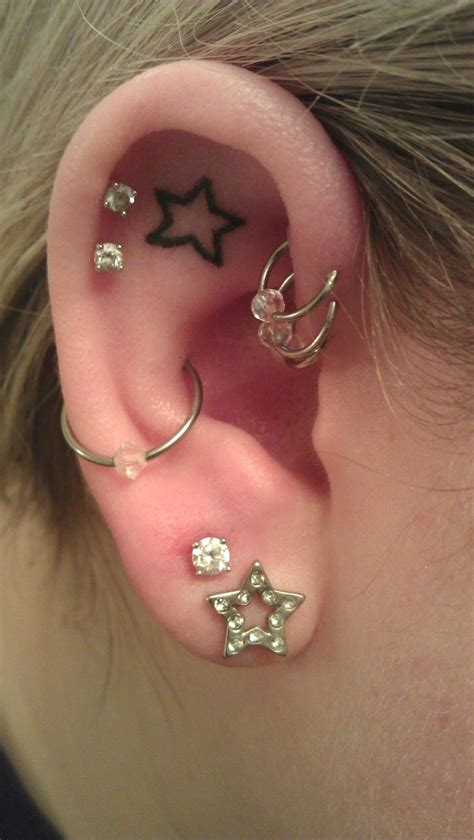 star tattoo and ear piercings so ready to get my inner ear