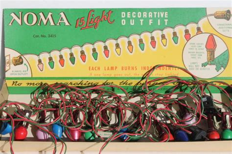 vintage noma christmas lights in original boxes a tree