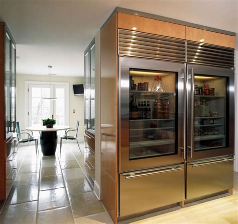 a glass front refrigerator residential in your home
