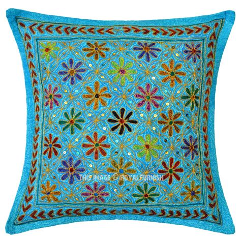 throw pillows on turquoise blue decorative needlepoint embroidered cotton