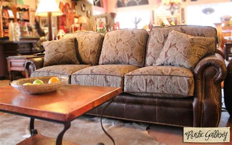 studded leather and paisley patterned fabric sofa
