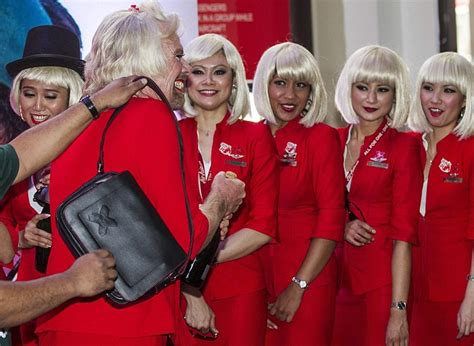 air asia bet sir richard branson dresses in drag after losing bet with