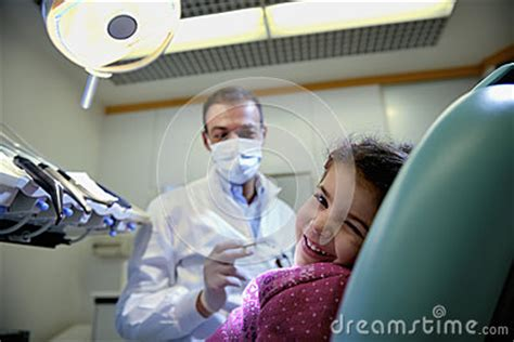 couch dental young girl lying on couch in dentist studio looking at