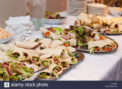 buffet wedding reception savory pancake wraps on buffet table at a wedding