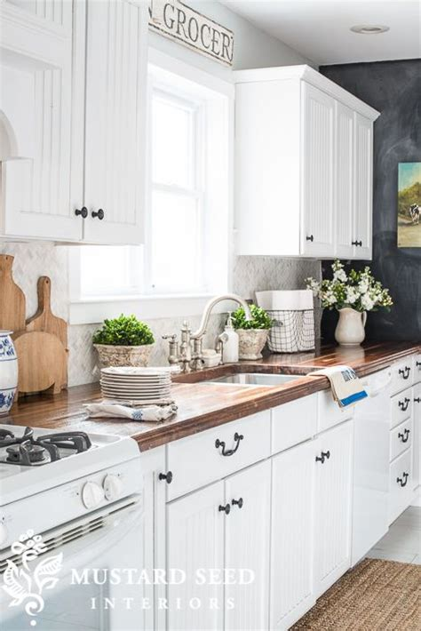 white kitchen cabinets with butcher block countertops white grey kitchen with chalkboard wall and butcher
